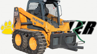 Skid Steer Loader Equipped With Tree and Post Puller Attachment