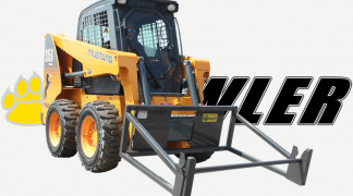Skid Steer Equipped With Sod Roller Attachment