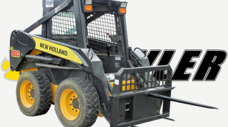 Skid Steer With Hay Bale Spear Attachment